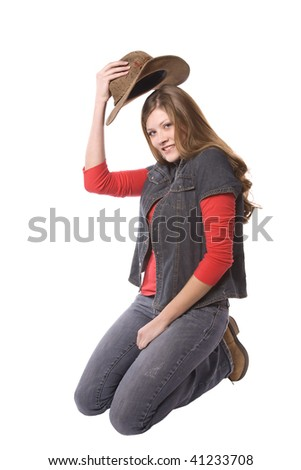 A woman holding a hat with a small smile on her face. - stock photo