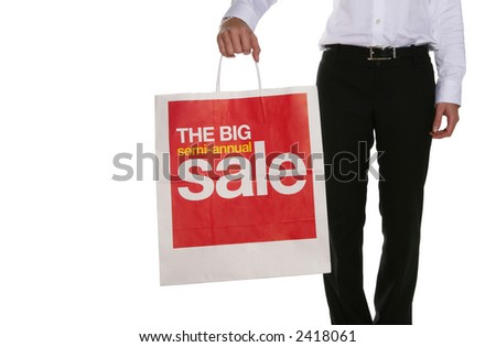 A woman holding a large sale bag for shopping - stock photo