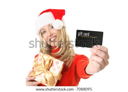 A woman holding a present and outstretched arm showing a gift card, credit card or other card or object.  Focus is the hand and card.  Change the card or text to suit your needs. - stock photo