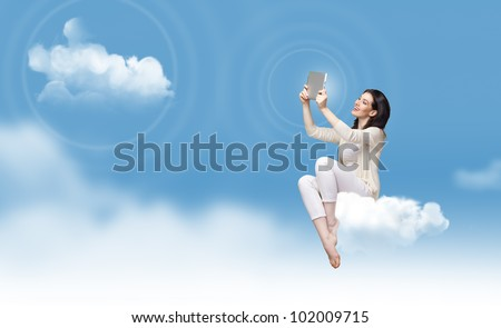 a woman holding a tablet pc - stock photo