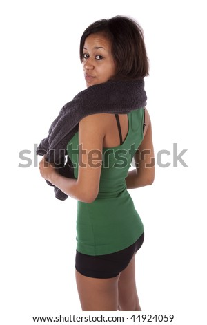 A woman holding a towel with a serious expression on her face. - stock photo