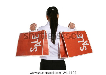 A woman holding a two large sale bags for shopping - stock photo