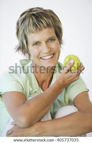 A woman holding an apple - stock photo