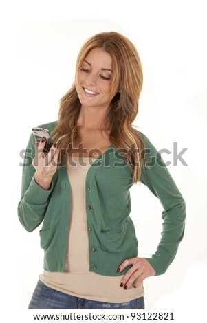 A woman holding her cell phone looking at it. - stock photo