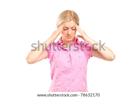 A woman holding her head in pain as a result of a headache isolated on white background - stock photo