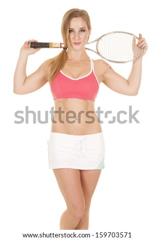 A woman holding on to her tennis racket with a small smile on her lips.