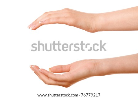 A woman holding something between hands, focus on female hands - stock photo