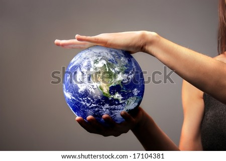 a woman holding the earth in her hands