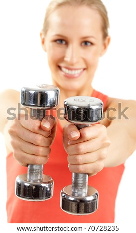 A woman holding two dumbbells - stock photo