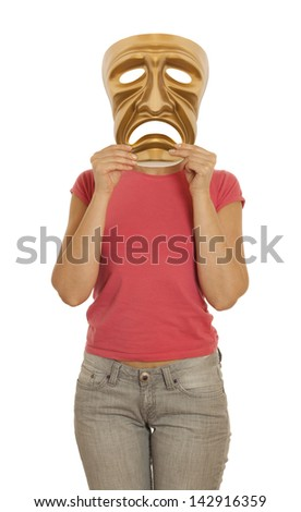 A woman holds a golden theatrical mask of tragedy - stock photo