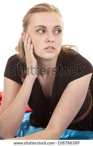 A woman in a black dress is looking to the side. - stock photo