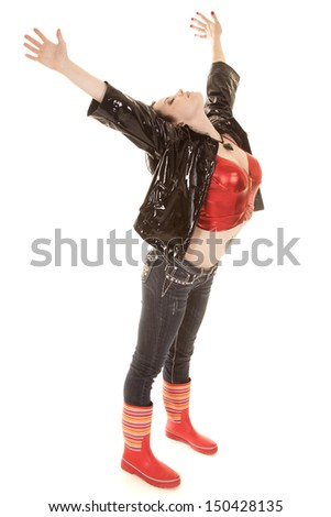 A woman in a black jacket and rain boots. - stock photo