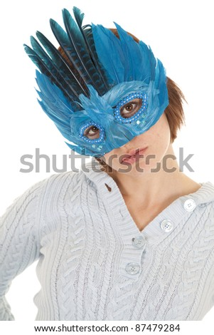 A woman in a blue mask with a serious expression.