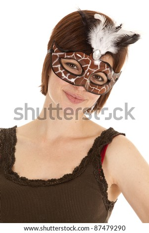 a woman in a brown mask with a feather with a small smile on her lips.