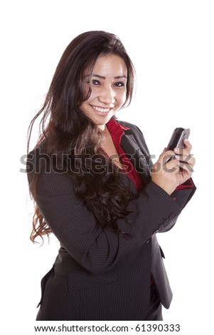 A woman in a business suit sending a text message. - stock photo