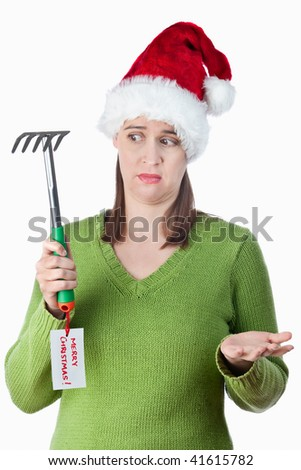 A woman in a funny Christmas scenario after receiving a not so good gift. - stock photo