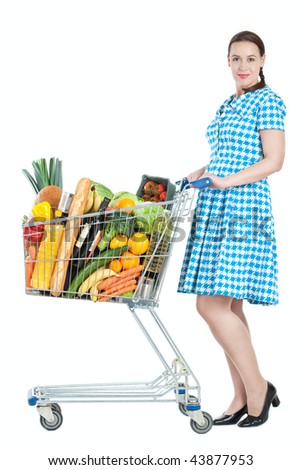 A woman in a housewife role with a full shopping cart - on a white background - stock photo