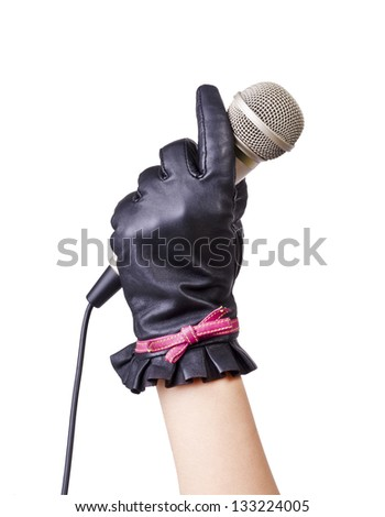 A woman in a leather glove holding a big black microphone for singing isolated on white background. - stock photo