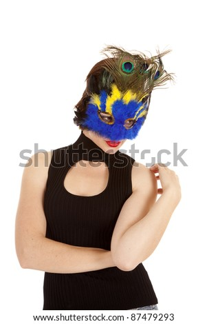 A woman in a mask with a sexy expression on her face. - stock photo