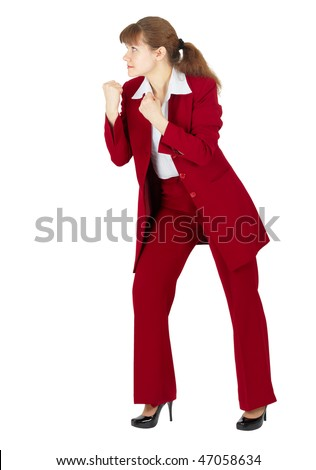 A woman in a red business suit in a combat stance