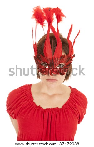 A woman in a red mask with a angry expression on her face.