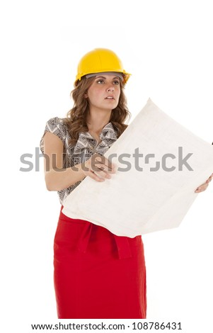 A woman in a red skirt is holding some blueprints. - stock photo