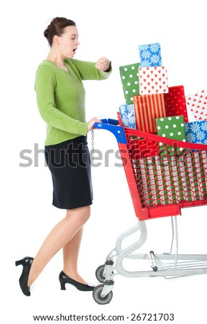 A woman in a shopping scenario late for something and under stress - stock photo