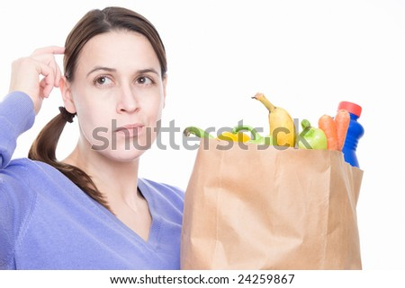 A woman in a shopping situation with a decision to make. - stock photo