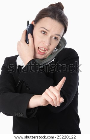 A woman in a trading role taking and placing multiple orders in a dealing situation. - stock photo