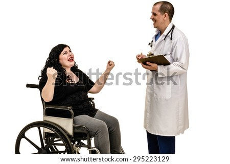 A woman in a wheelchair celebrates good news from the doctor