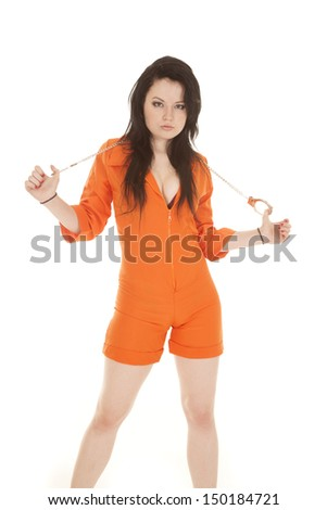 A woman in an orange prison outfit with handcuffs.