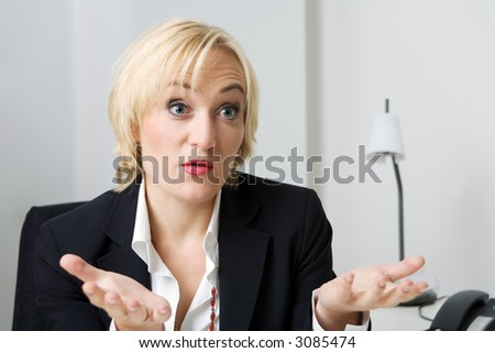 a woman in business clothes explaining something