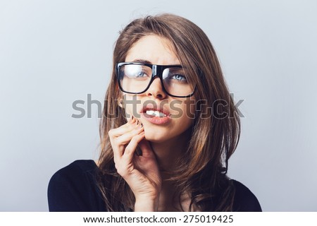 A woman in glasses, teeth hurt - stock photo