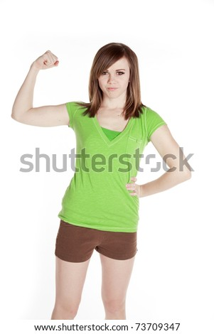 A woman in green is showing her muscles.