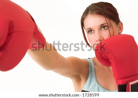 A woman in gym clothes, with boxing gloves