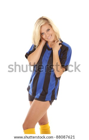 A woman in her black and blue striped uniform with a serious sexy expression on her face. - stock photo
