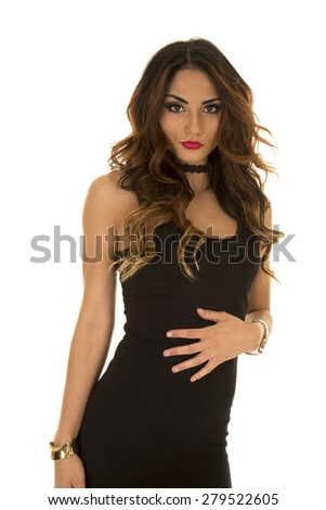 A woman in her black dress with a sensual expression. - stock photo