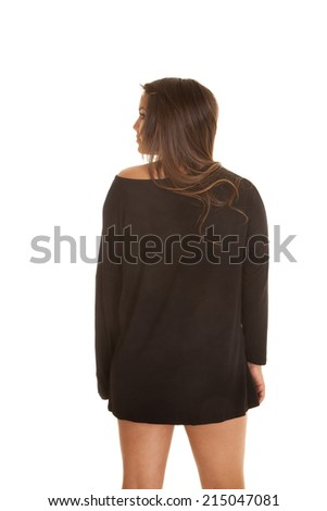 a woman in her black sweater dress, showing off the back.