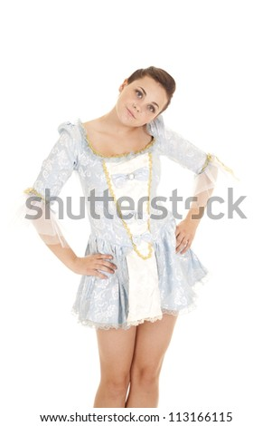 a woman in her blue dress with her hands on her hips and a serious expression on her face - stock photo