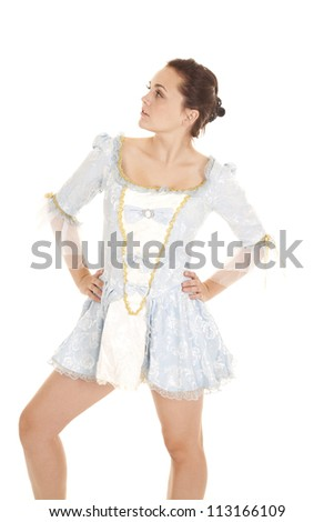 A woman in her blue short dress with her hands on her hips. - stock photo