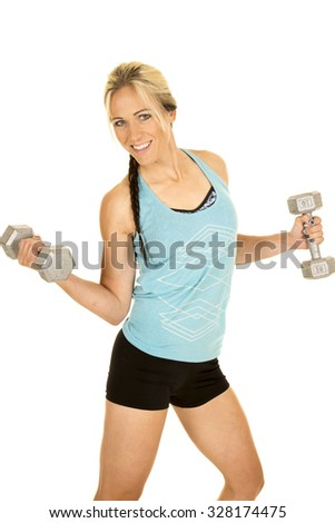 a woman in her blue tank with a smile, working out with weights.