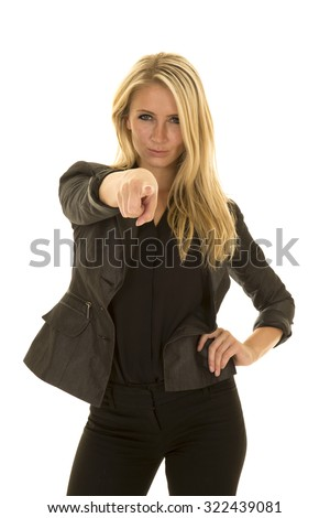 a woman in her business attire pointing her finger with an upset expression.