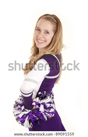 A woman in her cheer leading out fit with a smile on her face, - stock photo