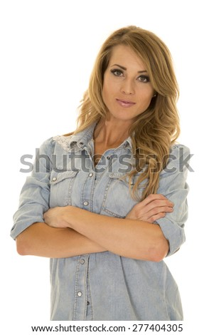 A woman in her denim top with a serious expression on her face.