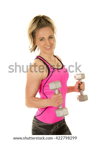 A woman in her fitness clothing working out with weights.