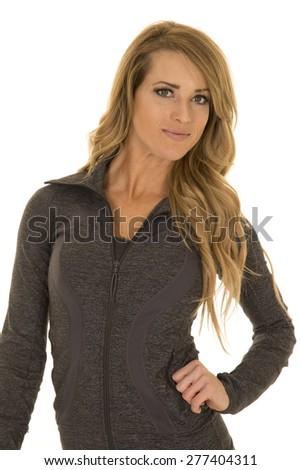 A woman in her fitness top with a smile on her lips. - stock photo