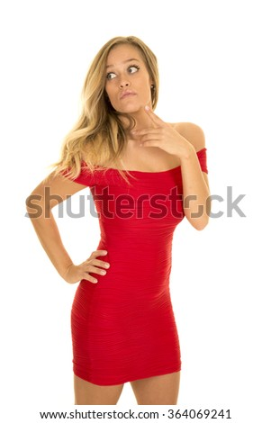 A woman in her fitted red dress with a thoughtful expression.