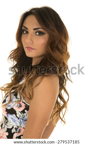A woman in her floral shirt with a sensual expression on her face. - stock photo