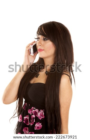 a woman in her flower dress talking on the phone. - stock photo