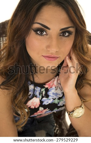 a woman in her flower dress top with a watch, looking with a sensual expression. - stock photo